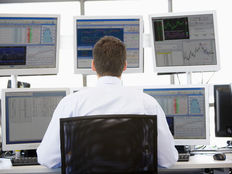 Photodune 316693 stock trader looking at multiple monitors xs
